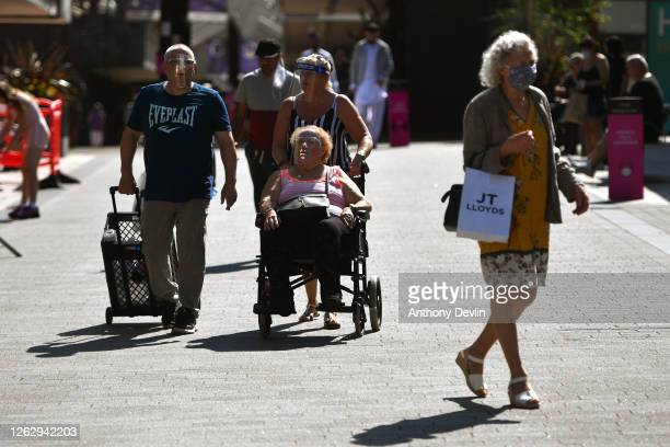 Shoppers wear face masks in Burnley town centre on July 31, 2020 in Burnley, England. Lockdown has been heightened in parts of England with a...