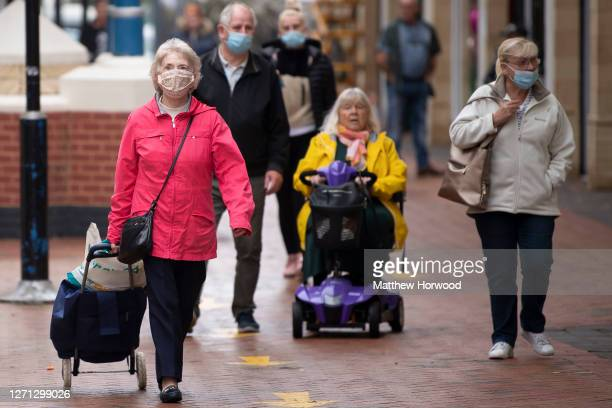 Shoppers wear face masks in Castle Court shopping centre on September 8, 2020 in Caerphilly, Wales. The county borough of Caerphilly in South Wales...