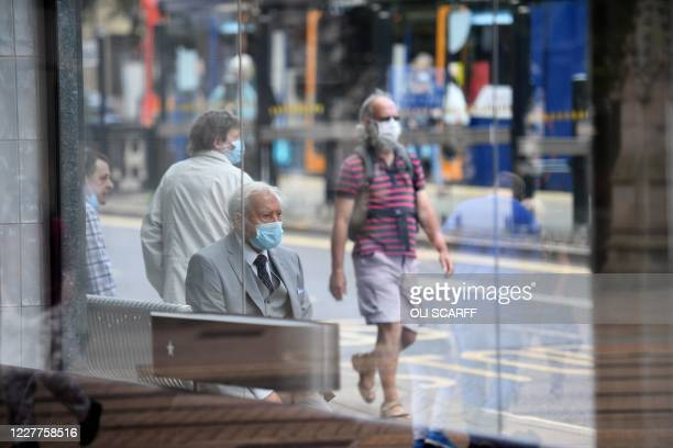 Shoppers wear face masks in the city centre of Sheffield, south Yorkshire on July 24 as lockdown restrictions continue to be eased during the novel...