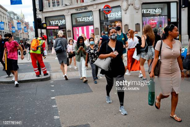 Shoppers wear face masks on Oxford Street in London on July 24 after wearing facemasks in shops and supermarkets became compulsory in England as a...