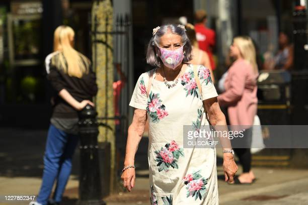 Shoppers wear facemasks as they walk through central Halifax on July 31 2020 Millions of households in Manchester and nearby parts of northern...