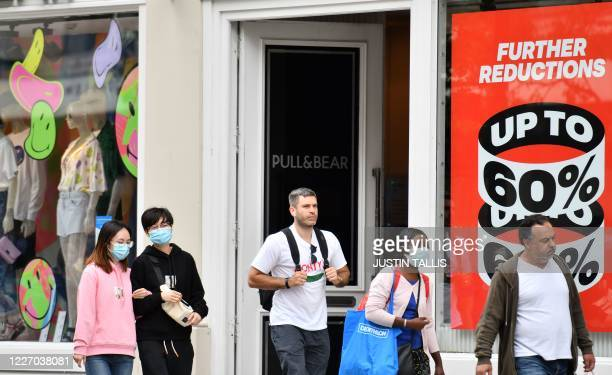 Shoppers wear masks as a precaution against the transmission of the novel coronavirus on Oxford Street in London on July 14 2020 Face masks will be...