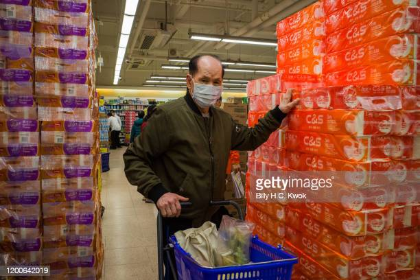 Shoppers wearing a face mask buying toilet papers in a supermarket on February 11 2020 in Hong Kong China