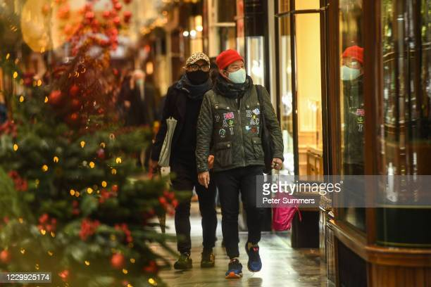 Shoppers wearing face masks are seen on December 3, 2020 in London, England. On Tuesday night, Dec 1, MPs voted in favour of government proposals to...