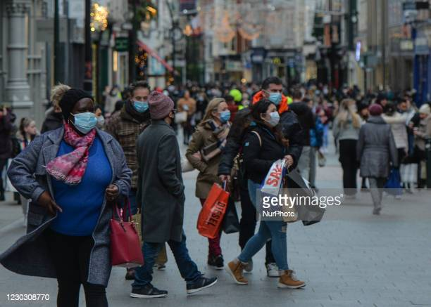 Shoppers wearing face masks seen on Grafton Street in Dublin city centre on St. Stephen's Day. Taoiseach Micheal Martin announced on December 22nd a...