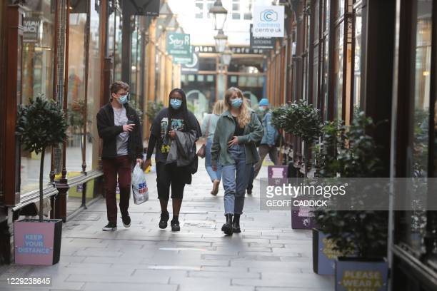 Shoppers wearing masks because of the coronavirus pandemic are seen in the centre of Cardiff on October 23 hours before Wales goes into a two-week...