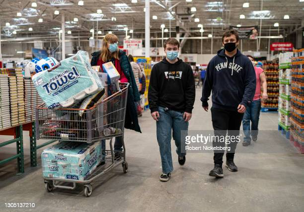 Shoppers wearing masks search for items at a Costco Wholesale store February 26, 2021 in Colchester, Vermont.