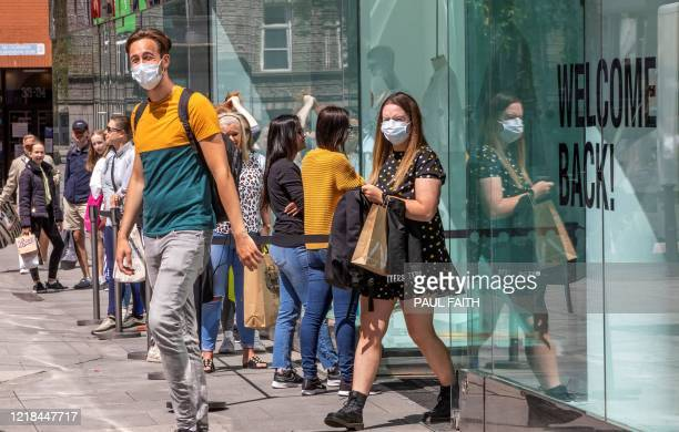 Shoppers wearing PPE including a face mask as a precautionary measure against COVID19 exit a reopened Zara store in Grafton Street in central Dublin...