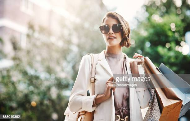 shopping always makes her happy - wealth stock pictures, royalty-free photos & images