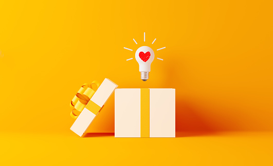 Shopping And Gift Concept- A Light Bulb With Heart Shape Coming Out Of White Gift Box 1131385093