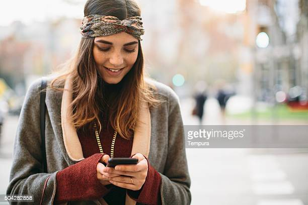 Shopping and texting on a winter day.