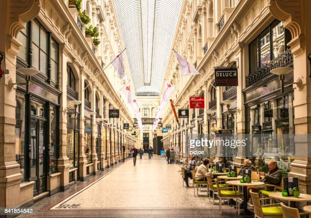 shopping arcade in the hague, netherlands. this image is gps tagged. - the hague stock photos and pictures