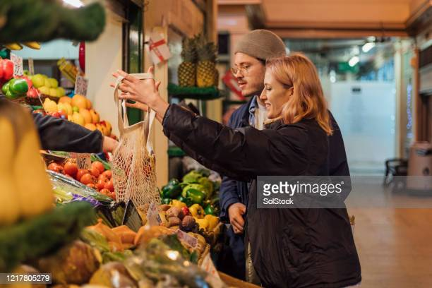 shopping at a greengrocers - shop stock pictures, royalty-free photos & images
