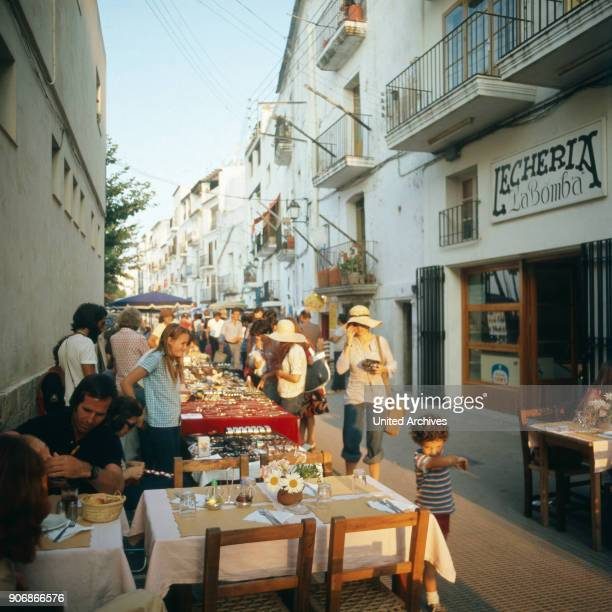 Shopping at a hippie market in the city of Ibiza Ibiza 1976