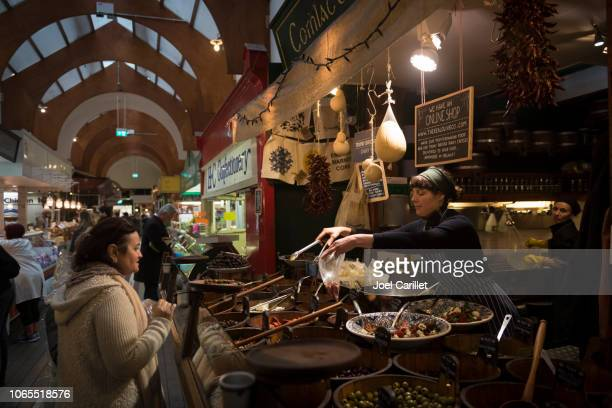 shopping at english market in cork, ireland - cork city stock pictures, royalty-free photos & images
