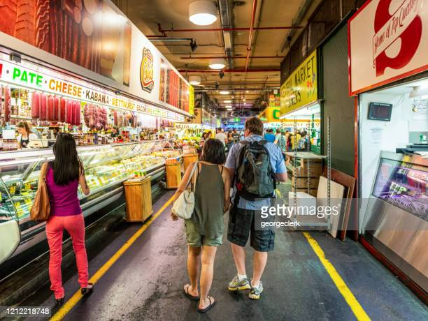 shopping at stalls within adelaide's central market - adelaide market stock pictures, royalty-free photos & images