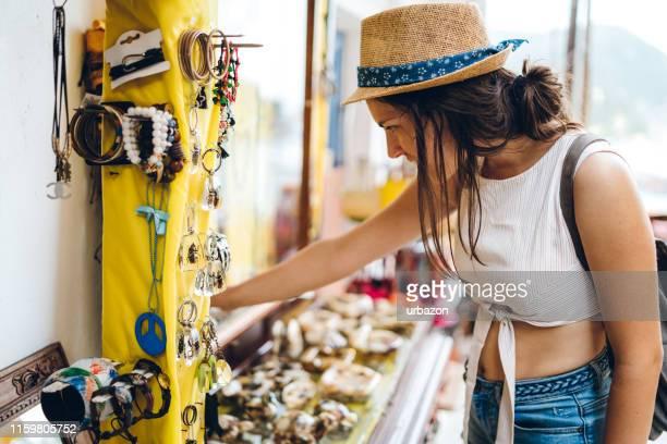 shopping at street market in parga - epirus greece stock pictures, royalty-free photos & images