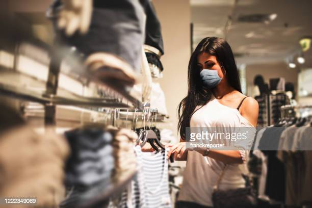 shopping at the time of corona virus - merchandise stock pictures, royalty-free photos & images