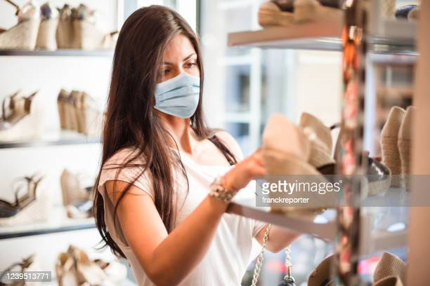 shopping at the time of corona virus - shoe store stock pictures, royalty-free photos & images