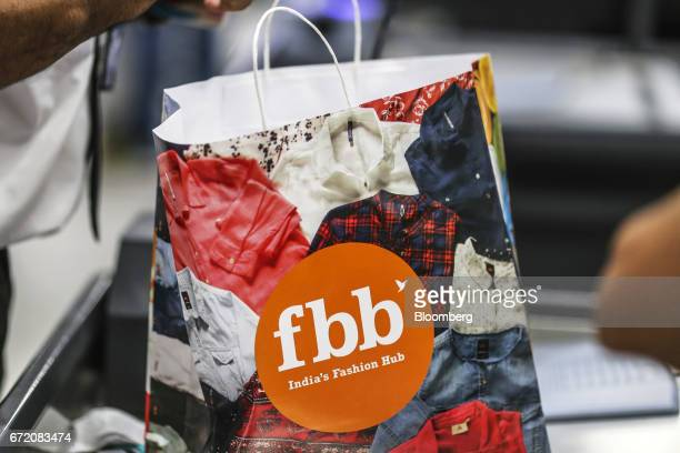 A shopping bag bearing a logo for Fashion @ Big Bazaar the fashion unit of Big Bazaar operated by Future Retail Ltd sits on a counter at a Big Bazaar...