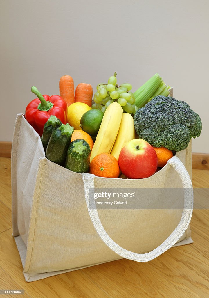 Shopping bag brimming with fresh fruit & vegetable : Stock Photo