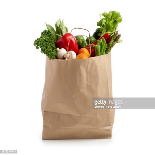 shopping bag full of fresh produce - shopping bag stock pictures, royalty-free photos & images