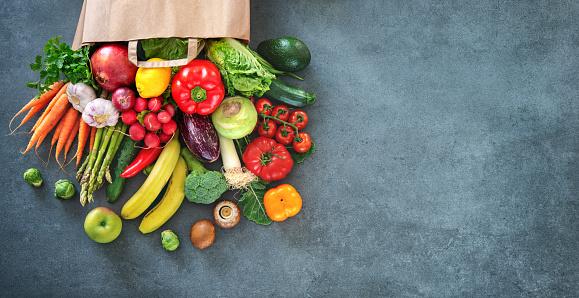 Shopping bag full of fresh vegetables and fruits 1128687119