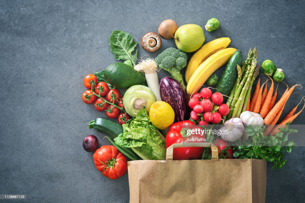 Shopping bag full of fresh vegetables and fruits : Stock Photo