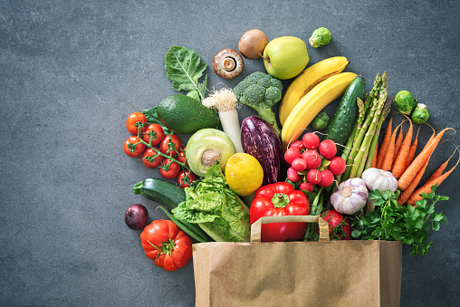 Shopping bag full of fresh vegetables and fruits 1128687123