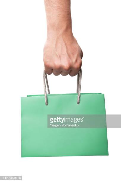 shopping bag in hand, green paper shopping bag - handle stock pictures, royalty-free photos & images