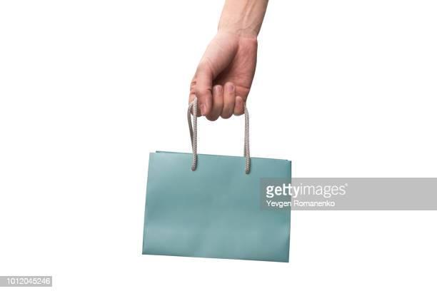 shopping bag in hand - attività che richiedono movimento foto e immagini stock