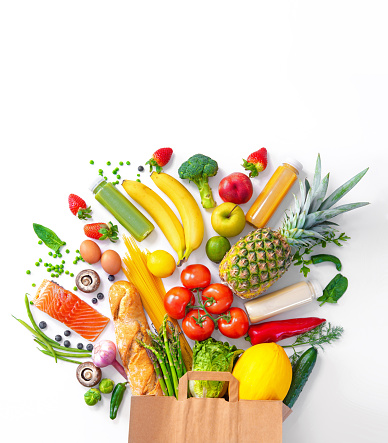 Shopping bag with groceries full of fresh vegetables and fruits 1131795561