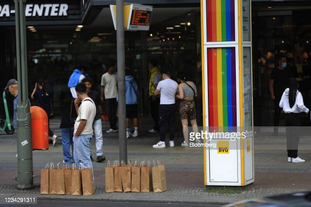 Shopping bags and customers in Berlin, Germany, on Thursday, July 29, 2021. Germany reports gross domestic product figures on July 30. Photographer:...