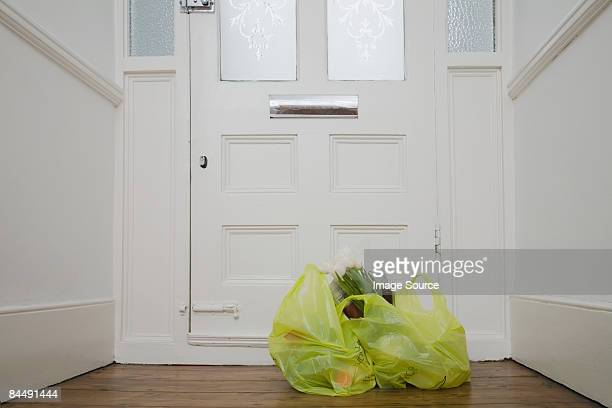 Shopping bags by front door