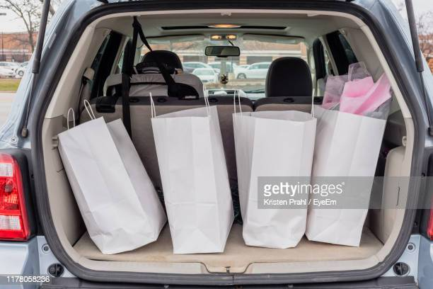 shopping bags in car trunk - car trunk stock pictures, royalty-free photos & images