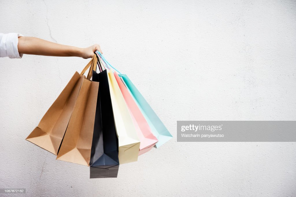 Shopping bags of women crazy shopaholic person at shopping mall.colorful paper shopping bags. : Stock Photo
