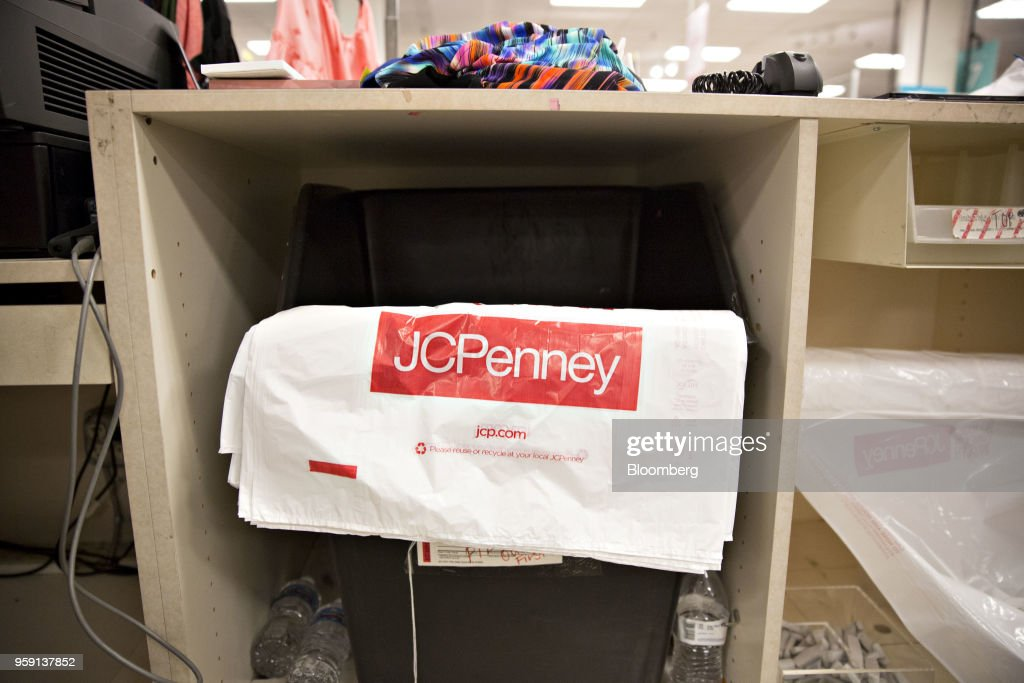 Shopping bags sit behind a cash register inside a J.C. Penney Co. store in Peoria, Illinois, U.S., on Saturday, May 12, 2018. J.C. Penney Co. is scheduled to release earnings figures on May 17. Photographer: Daniel Acker/Bloomberg via Getty Images