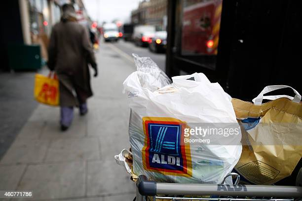 Shopping bags sit in an Aldi shopping cart outside an Aldi Stores Ltd supermarket in the Kilburn district of London UK on Monday Dec 22 2014 German...