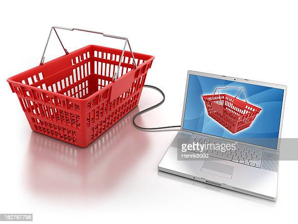 Shopping basket connected to laptop - isolated with clipping path