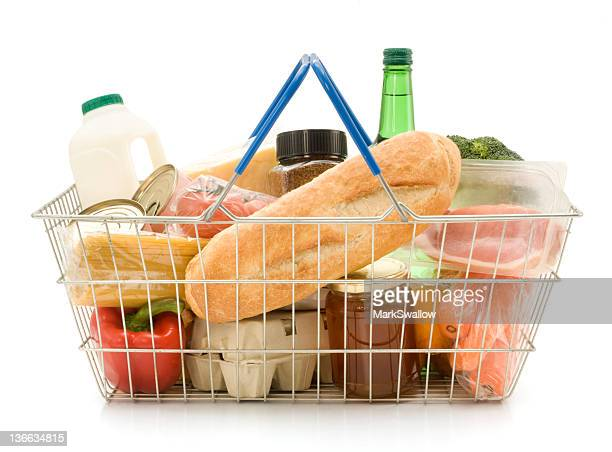 a shopping basket filled with food - basket stock pictures, royalty-free photos & images
