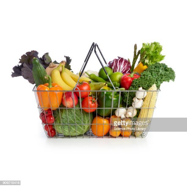 shopping basket full of fresh produce - basket stock photos and pictures