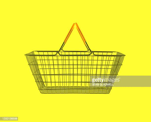 shopping basket on yellow - for sale stock pictures, royalty-free photos & images