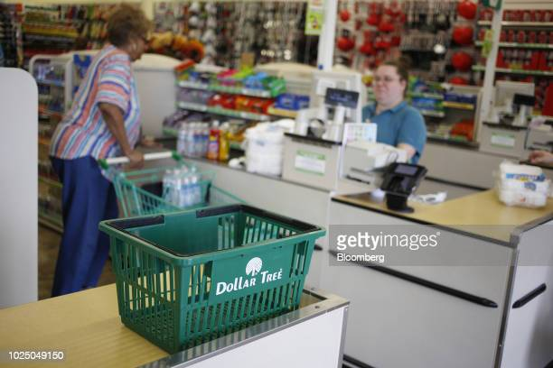 A shopping basket sits on a checkout counter at a Dollar Tree Inc store in Louisville Kentucky US on Friday Aug 24 2018 Dollar Tree Inc is scheduled...