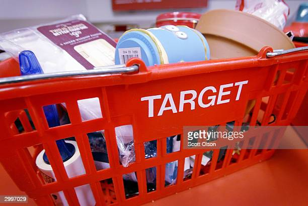 A shopping basket sits on the counter at a Target Store February 19 2003 in Chicago Illinois Target Corp today reported a 21 percent jump in earnings...