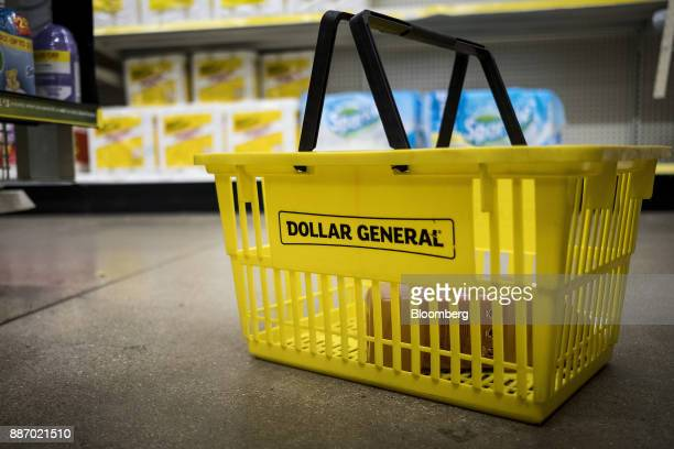 A shopping basket sits on the floor inside a Dollar General Corp store in Chicago Illinois US on Wednesday Nov 29 2017 Dollar General is scheduled to...