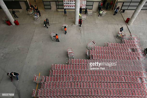 Shopping carriages are linedup outside of a recently opened Costco warehouse store on November 13 2009 in New York City The store the first in...