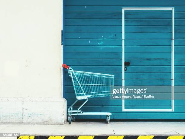 Shopping Cart Against Closed Gate