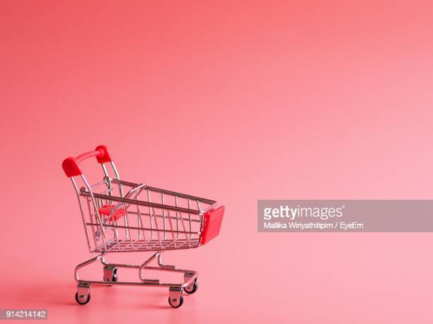 Shopping Cart Against Pink Background