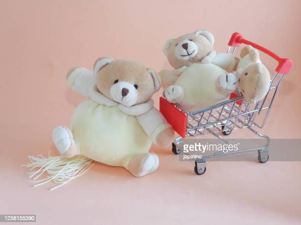 shopping cart and teddy bears - teddy bear stock pictures, royalty-free photos & images