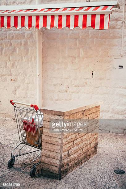 Shopping Cart By Retaining Wall Under Awning